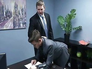 Young gay secretary gets big cock in the office